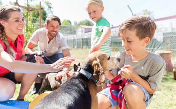 Parents and Children Playing with Adopted Shelter Dog | Family Life Tips Magazine