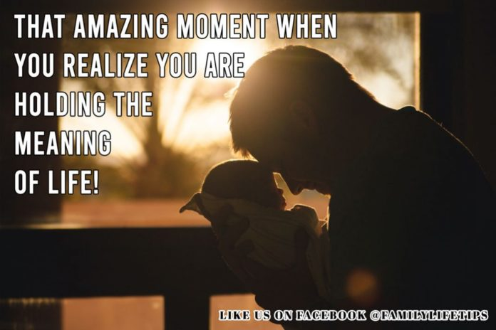 Baby Meme: That amazing moment when you realize you are holding the meaning of life! Pictured is New Born Baby and Father Holding Baby with Rising Sun in the Background.