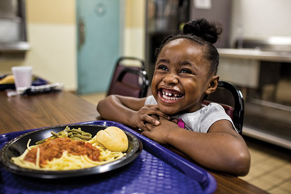 Young African American Girl Excited About Eating Healthy School Lunch